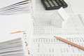 Pencil and house on finance account have calculator place with pile of paperwork Stock Photos