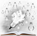 Pencil and light bulb on open book use for creative idea topic Royalty Free Stock Images