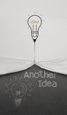 Pencil lightbulb draw rope open wrinkled paper show another idea words as concept Stock Images