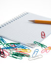 Pencil on the notepad composition closeup with clips isolated Stock Image
