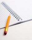Pencil on the notepad composition closeup isolated Royalty Free Stock Photo