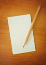 Pencil and notepad on wooden table Royalty Free Stock Photography