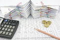 Pencil pile of gold coin and calculator place on finance Royalty Free Stock Photo