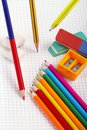 Pencil rubbers and colors to crayon colored pencils other objects from school on a sheet of notebook as i break down Stock Image