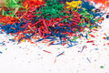 Pencil shavings of different colors on white Royalty Free Stock Photo