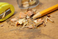 Pencil with shavings yellow and sharpner on rustic wood Royalty Free Stock Photo