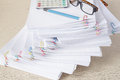 Pencil with spectacles and calculator on stack of overload paper Royalty Free Stock Photo
