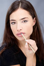 Pencil on woman s lips applying cosmetic Royalty Free Stock Images