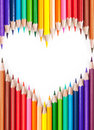 Pencils colored in a heart shape isolated on white background Stock Image