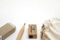 Pencils, erasers, pencil sharpeners and fabric bag Royalty Free Stock Photo