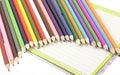 Pencils on the exercise book Stock Photos