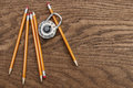 Pencils and lock on wood surface Royalty Free Stock Photo