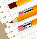 Pencils & paper in line Stock Photography