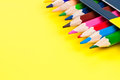 Pencils on yellow background. Royalty Free Stock Image