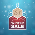 Pendant big winter sale beige and wine colored blue background snowflake Stock Photography