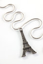 Pendant a closeup of a eiffel tower on a silver chain Stock Photo