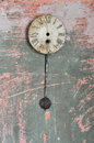 Pendulum clock ancient on a broken wall Stock Photo