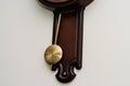Pendulum detail of a vintage looking modern wall clock Stock Image