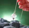 Pendulum hand with tool for dowsing Stock Image