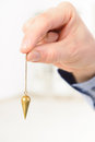 Pendulum hand with tool for dowsing Royalty Free Stock Photo