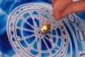 Pendulum with zodiac Stock Photo