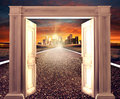 Pened door on empty road towards a distant city d rendering opened conceptual new way entrance to new world heaven life hope Royalty Free Stock Images