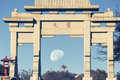 Peng yuan gate on mount tai a waning moon over the mountains of shan and in shandong province china in the morning light Royalty Free Stock Images