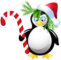 Penguin with christmas candy and santa hat Stock Images