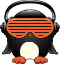 Penguin in the headphones isolated on white Royalty Free Stock Photo