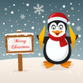 Penguin with Merry Christmas Sign Royalty Free Stock Photo
