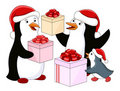 Penguin's family with gifts Royalty Free Stock Photo