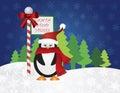 Penguin at Santa Stop Here Sign Royalty Free Stock Photo