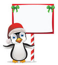 Penguin with Sign Royalty Free Stock Photo