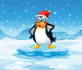A penguin wearing santa s hat standing above an iceberg illustration of Stock Images