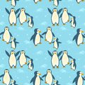 Penguins family on ice seamless pattern.