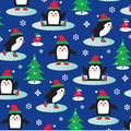 Penguins on ice skates christmas and trees Stock Photo