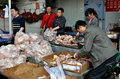 Pengzhou, China: Butchers Packing Pig Parts Royalty Free Stock Photos