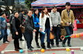 Pengzhou, China: Chinese Playing Ring Toss Royalty Free Stock Photo