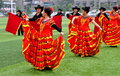 Pengzhou china dancers performing flamenco routine a group of in colourful red and yellow costumes rehearsing a on the astroturf Stock Images