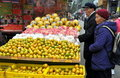 Pengzhou, China: Elderly Couple at Fruit Stand Royalty Free Stock Photo