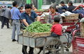 Pengzhou, China: Family at Wholesale Market Stock Image