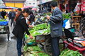 Pengzhou china farmers selling greens at market farm fresh produce the busy outdoor long xing marketplace in Royalty Free Stock Photo