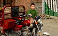 Pengzhou, China: Little Boy on Motorcyle Stock Images