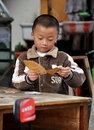 Pengzhou, China: Little Boy Playing Cards Royalty Free Stock Photo