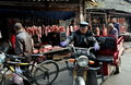 Pengzhou china long xing market butcher shops with their displays of meat hanging from iron hooks on a busy street at the outdoor Stock Photo