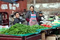 Pengzhou, China: Long Xing Market Vendors Stock Images