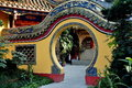 Pengzhou china moon gate at ci ji temple a flanked by gardens leads into an inner courtyard the buddhist in Stock Image