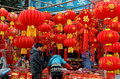 Pengzhou china people shopping for decorations husband and wife chinese new year at a vendor s street booth in Royalty Free Stock Image
