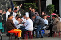 Pengzhou china restaurant workers playing cards friendly and chefs sitting outside between the lunch and dinner service in Stock Photos