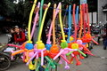 Pengzhou, China: Street Vendor Selling Balloons Royalty Free Stock Photo